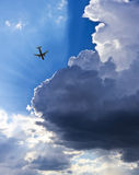An Airliner, Blue Sky, Clouds and Sunbeams Stock Images