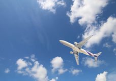 Airliner on the blue sky Stock Photo