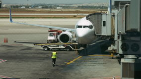 Airliner boarding and unloading timelapse. Airliner is boarding and unloading in international airport terminal timelapse. Airport terminal and airfield traffic stock footage