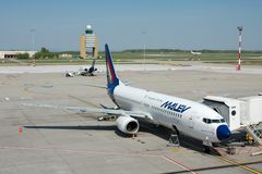 Airliner. BUDAPEST, HUNGARY - MAY 02: Malev Hungarian Airlines Boeing 737 ground handling MAY,02 2009. Malev ceased all flying activity on 3 February 2012, after Royalty Free Stock Image