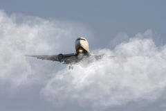 Airliner through the clouds Stock Images