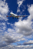Airliner and clouds stock images