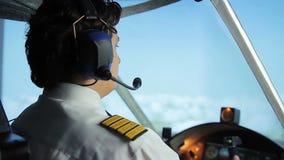 Airliner crew commander navigating plane in blue sky, passenger transportation. Stock footage stock video