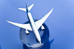 Airliner with earth in the blue background Stock Photo