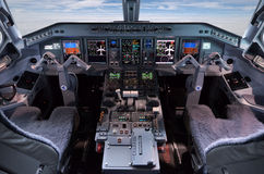 Airliner Embraer 195 pilots cocpit Royalty Free Stock Photos