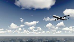Airliner flies over ocean Royalty Free Stock Photo