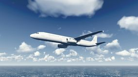 Airliner flies over ocean 4 Stock Images