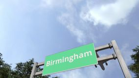 Airliner flies to Birmingham. Travelling to the United Kingdom conceptual 3D animation. Airliner landing in the city. 3D stock footage