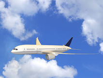 Airliner in flight. With beautiful blue sky and puffy white clouds Stock Images