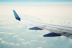 Airliner in flight. Over a clouds Royalty Free Stock Image