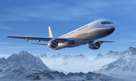 Airliner flight over the snowy mountains Royalty Free Stock Photo