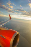 Airliner in flight at sunset Royalty Free Stock Photography