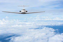 Airliner fly over clouds Royalty Free Stock Image
