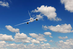 Airliner Flying Stock Photography