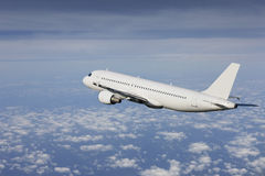 Airliner flying Royalty Free Stock Image