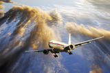 Airliner flying above sunset clouds Stock Photos