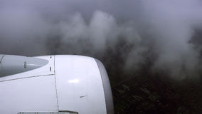 Airliner is flying in a bad weather conditions Stock Photography