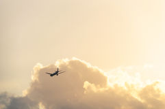 Airliner flying in the evening light Stock Image