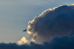 Airliner flying in the evening light Stock Images