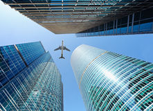 Airliner flying over skyscrapers Stock Photo