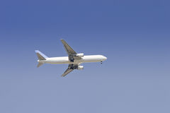 Airliner flying in sky Stock Photo