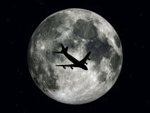 Airliner in front of the moon Royalty Free Stock Photography
