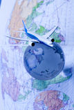 Airliner with a globe. Travel concept, airliner and world Stock Photos