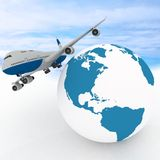 Airliner with globe Royalty Free Stock Images