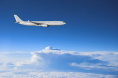 Airliner high above. Jumbo jet flying high above a thunderstorm Royalty Free Stock Photos