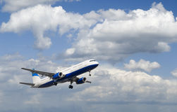 Airliner In Cloudy Sky Royalty Free Stock Image