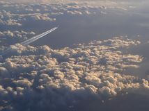 The airliner jets above the clouds royalty free stock photos