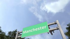 Airliner arrives in Manchester, the United Kingdom. 3D animation. Airliner landing in the city. 3D stock footage