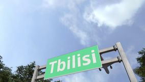 Airliner arrives in Tbilisi, Georgia. 3D animation. Airliner landing in the city. 3D stock footage