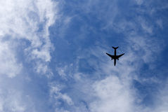 Airliner landing in cloudy sky. Jet airliner landing in cloudy sky royalty free stock images