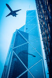 Airliner and modern glass building. At dusk in Hong Kong Stock Image