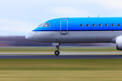 Airliner in motion. Motion blur of airliner speeding down the runway Stock Image