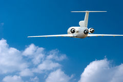 Airliner over clouds royalty free stock photo