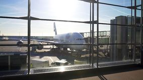 Airliner parked near passenger boarding bridge, comfortable long distance flight. Stock footage stock video