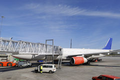 Airliner at passenger dock Royalty Free Stock Photo