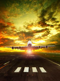 Airliner plane take off from airport runway against beautiful su Stock Photo