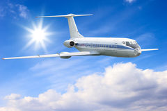 Airliner in sky. Airliner flying in high altitude blue sky Stock Images