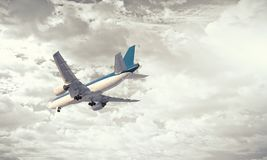 Airliner in sky. Mixed media. Airplane in sky that going down for landing. Mixed media Stock Photography