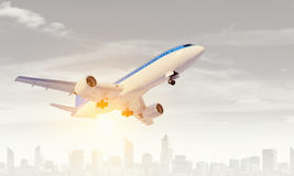 Airliner in sky. Mixed media. Airplane taking off and flying away in to sky. Mixed media Royalty Free Stock Image