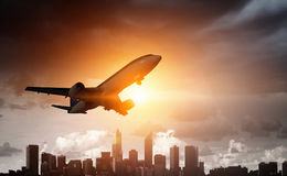 Airliner in sky. Mixed media Royalty Free Stock Image