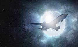 Airliner in sky. Mixed media Royalty Free Stock Photos