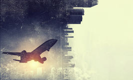 Airliner in sky. Mixed media. Silhouette of airplane taking off and flying away in to sky. Mixed media Stock Photography