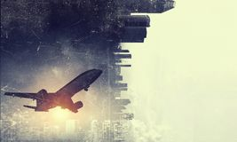 Airliner in sky. Mixed media. Silhouette of airplane taking off and flying away in to sky. Mixed media Stock Photos