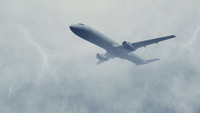Airliner in a stormy sky with lightnings Stock Photo