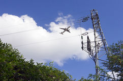 Airliner take off and Electricity pylon stock photo