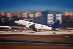 Airliner taking off from the airport - motion blur Royalty Free Stock Image